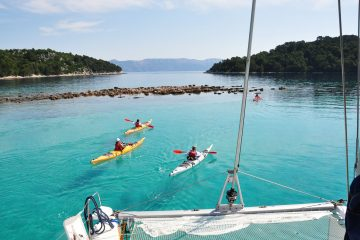 Mljet-catamaran-and-sea-kayaks