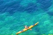 Sea kayaker on the beach