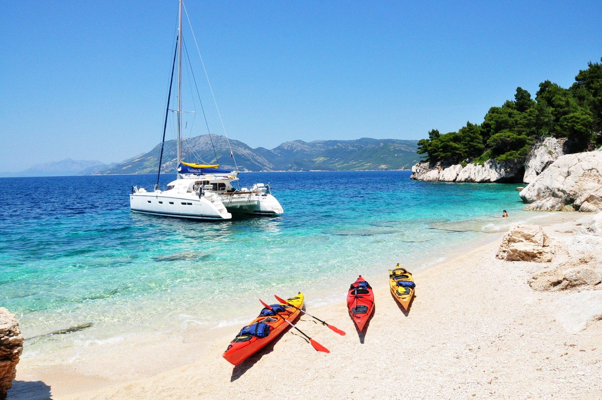 Catamaran and kayaks on the beach